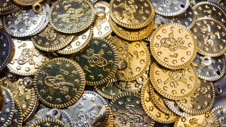 gold and silver coins: Fake gold and silver coins closeup Stock Photo