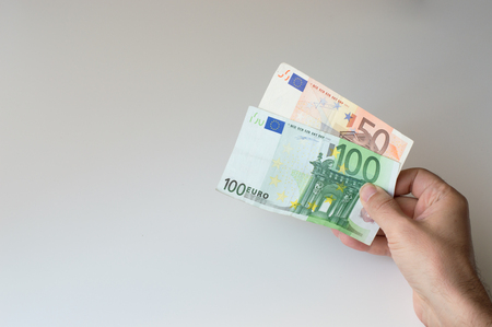 fifty euro banknote: Man holding a hundred and fifty  Euro banknote in his hands