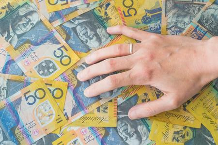 woman's hand: Womans hand on Australian Dollar banknote Stock Photo