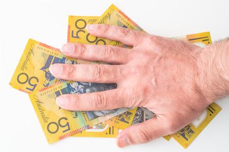Man's hand on Australian Dollar banknote Stok Fotoğraf
