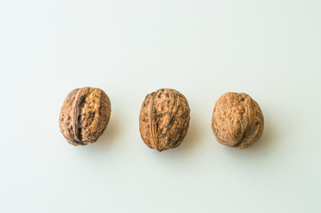 hard core: Walnuts in shell on a white background Stock Photo