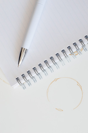 coffee stains: Coffee Stains and Notebook on White Background Stock Photo