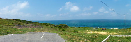 shrubbery: Panoramic View of Desolated Road Near the Sea Stock Photo