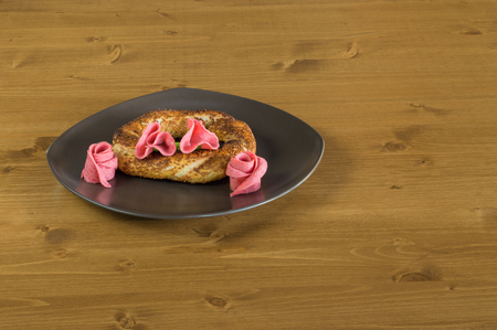sesame street: Traditional Turkish Pastry (Simit) with salami served on a grey plate on a wooden table