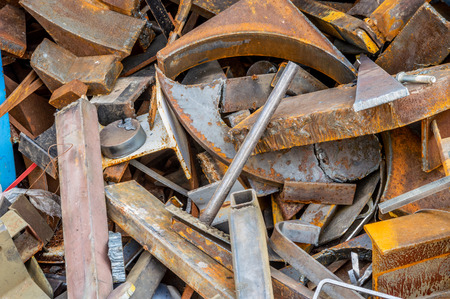 Recycling plant site filled with scrap metal, industrial garbage. Stock Photo