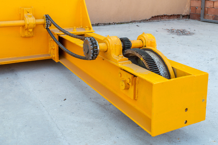 Parts of a crane ready for installation in the industrial plant. Overhead crane commonly called a bridge or gantry crane is a type of crane found in industrial environments.