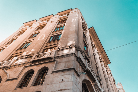 Low angle view of a historical buildings in Karakoy, the modern name for ancient Galata, commercial quarter in the Beyoglu district of Istanbul, Turkey Stock Photo