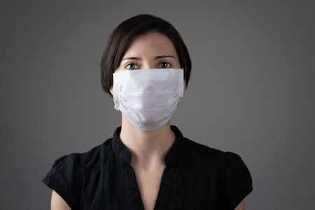 Brunette woman wearing hygienic mask to prevent infection Stok Fotoğraf