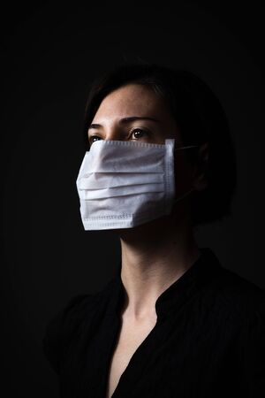 Adult woman wearing hygienic mask to prevent infection, airborne respiratory illness such as flu Stok Fotoğraf