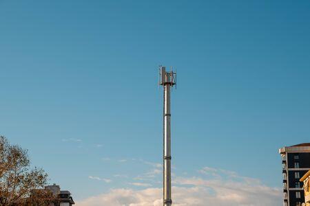 Telecommunication tower antenna on blue sky background Stok Fotoğraf