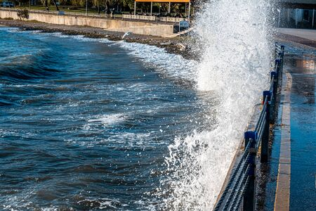 Powerful waves breaking at seawall during storm at daytime in Istanbul. Stockfoto