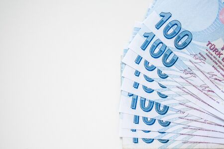 Bunch of 100 Turkish Lira (TRY) banknotes isolated on white background. Money growth and deposit accumulation concept.