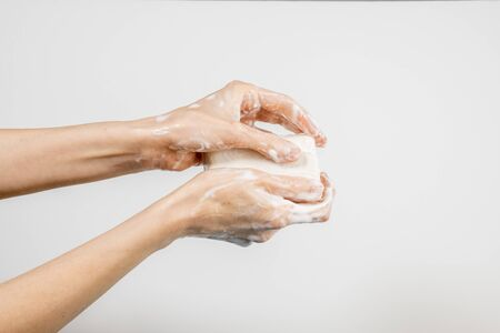 Close up of Caucasian woman washing her hands with bubbly soap bar isolated on white background. Demonstration of hand washing. Concept of hygiene and prevention coronavirus. Stok Fotoğraf