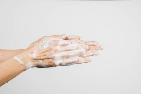 Close up of Caucasian woman washing her hands isolated on white background. Demonstration of hand washing. Concept of hygiene and prevention coronavirus. Stok Fotoğraf
