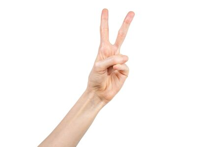 Caucasian female hand making peace sign with her hand on white background. Hand gesture. Gesticulation concept.