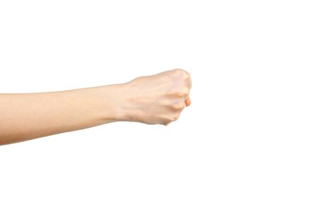 Caucasian female clenched fist on white background. Hand gesture. Gesticulation concept.