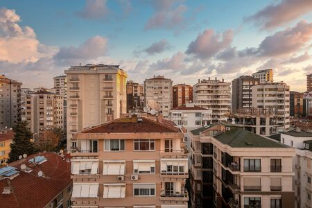 Aerial view of city apartment buildings with beautiful sunset view in Suadiye, Istanbul, Turkey