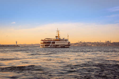 Istanbul, Turkey - November 30, 2019: Passengers on the ferryboat in Kadikoy. Every day nearly 150,000 passengers use ferries in Istanbul, due to easy access to two different continents.