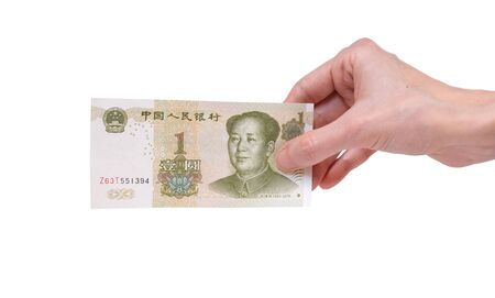 Female hand holding a 1  Chinese Yuan banknote isolated on a white background. Denomination of 1 Yuan. Stok Fotoğraf