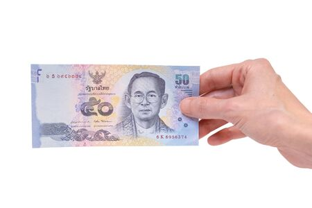 Female hand holding a 50 Thai Baht banknote isolated on a white background. Denomination of 50 Bahts. Stok Fotoğraf