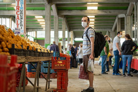 Eskisehir, Turkey - May 21, 2020: Man with medical mask at traditional Turkish grocery bazaar during corona days in Eskisehir, Turkey. Editöryel