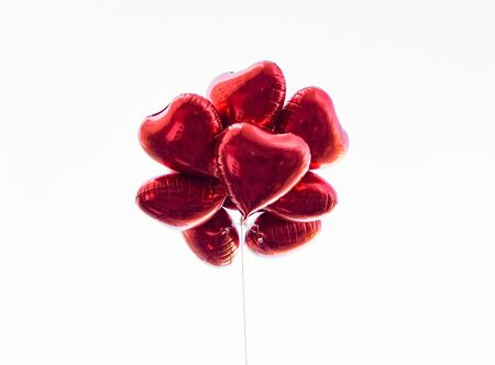 Group of heart shaped red air baloon on white background. Valentine's day and romance concept. Stok Fotoğraf
