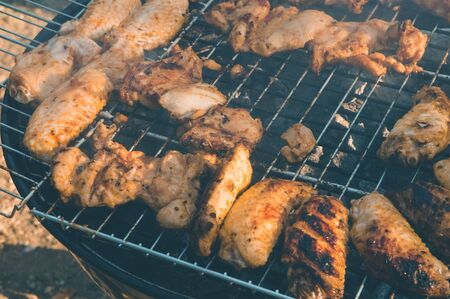 Close up of delicious and juicy chicken meat being cooked on a charcoal barbeque grill. Tasty snack party. Stok Fotoğraf - 150026401