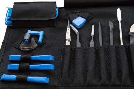 Set of professional tools in a case for repairing smartphones, computers and other office equipment. Stok Fotoğraf - 150444015