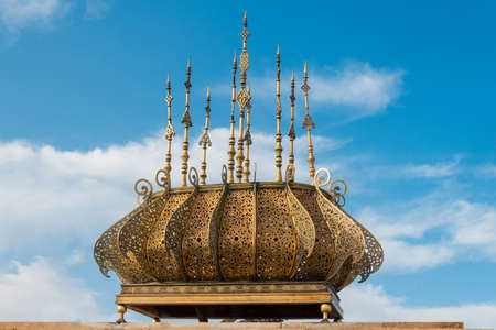 Golden roof at the Mausoleum of King Mohamed V and Tower of Hassan at Rabat, Morocco.
