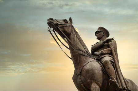 Bursa, Turkey - August 11, 2020: Bronze memorial statue of Mustafa Kemal Ataturk on his horse, the founder of the Republic of Turkey, over the sunset sky. Editöryel