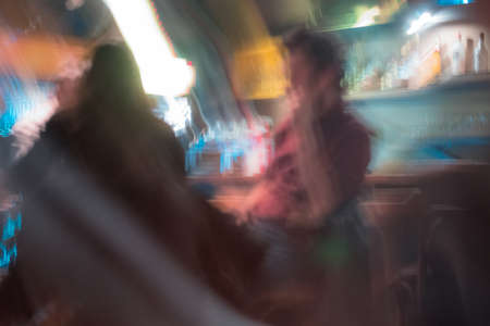 Long exposure photography of unrecognizable people at bar. Socialising concept. Stok Fotoğraf