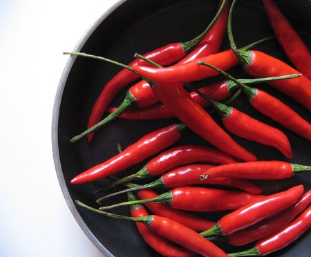 Chili peppers in pan Stock Photo