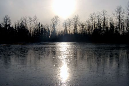 frozen lake: Frozen pond with sunlight reflecting Stock Photo