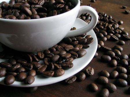 coffeebreak: White coffee cup with beans