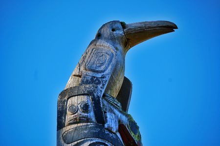 northwest indian art: Raven totem against blue sky