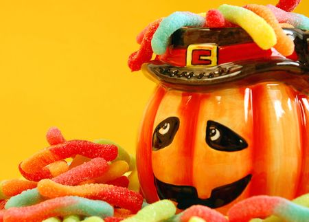 Pumpkin with candy worms photo