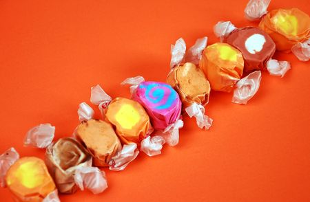 taffy: Taffy candy on orange background
