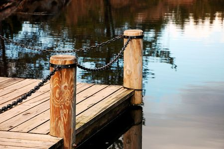 reflective: Dock on reflective pond Stock Photo