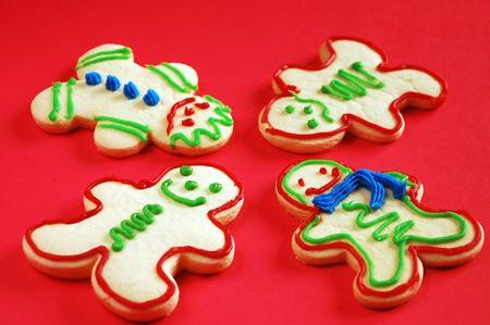 Gingerbread men on red background Stock Photo - 5498169