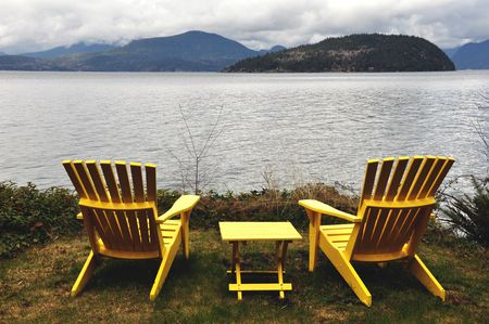 Empty deckchairs and ocean view 写真素材
