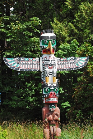 Totem pole in Vancouver, Canada photo