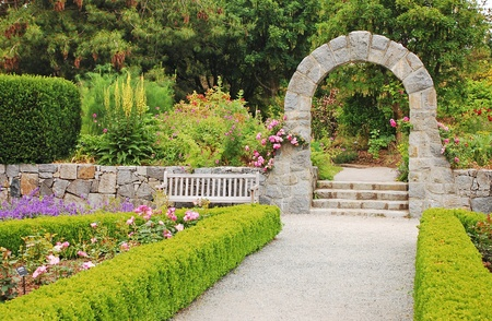 Stone arch in botanical garden photo