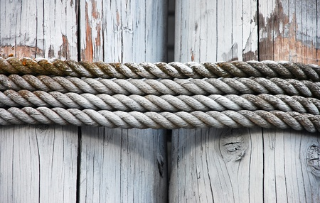 Strands of old rope tied on wooden planks