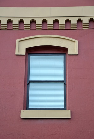 Old window in stucco exterior wall Stock Photo