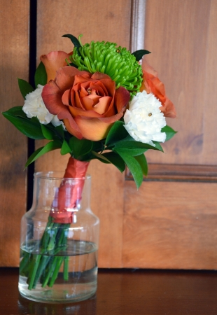Glass vase with bridal bouquet photo
