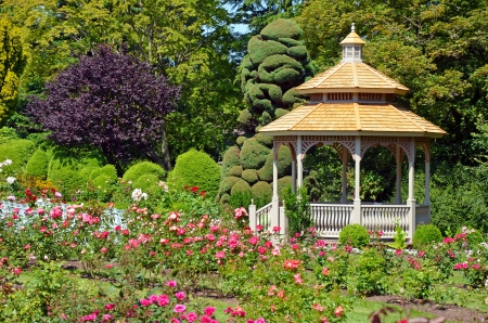 Wooden gazebo in colorful spring garden