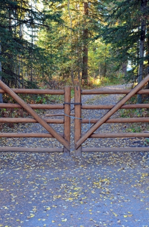 barrier: Wooden gate on ranch during autumn season