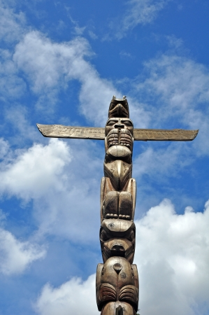 pacific northwest: Pacific northwest totem pole with blue sky and clouds in background