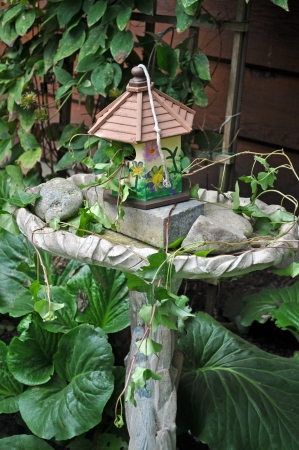 Decorative birdhouse and birdbath Stock Photo - 17170531