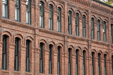 many windows: Old brick building with many windows Stock Photo